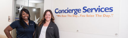 Patient concierges in front of the office