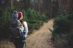 woman hiking w/toddler in backpack