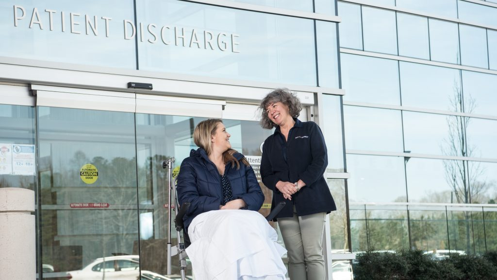 Hospital Concierge helping a patient's discharge.