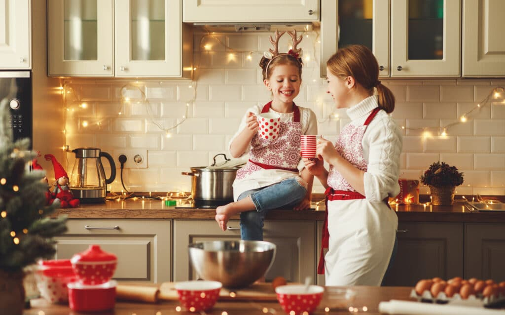 happy family mother and child bake christmas cookies