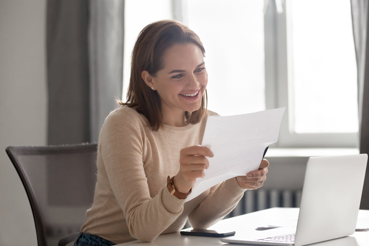 woman at a desk reading