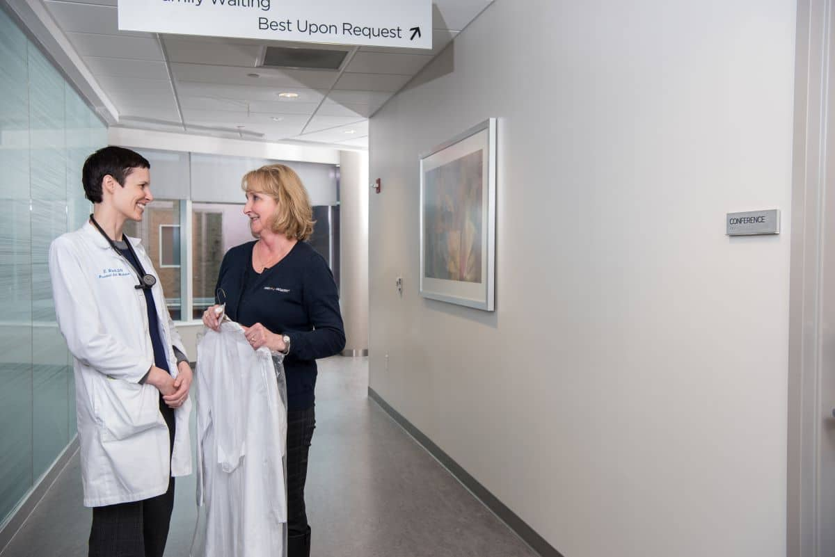 Physician Concierge delivering dry cleaning to a physician.